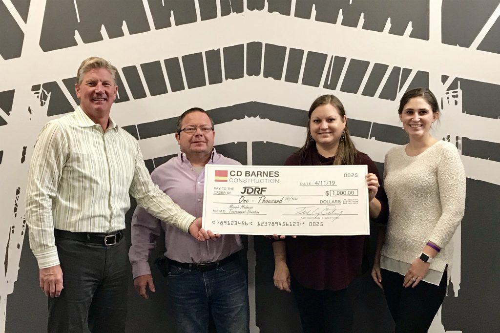 CD Barnes presents JDRF with check
